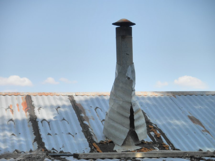 Steel Roof Chimney : How to flash a chimney pipe on metal roof stalling