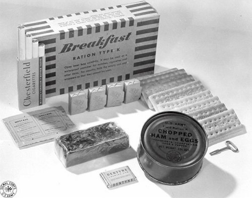 Breakfast Unit  Canned meat product Biscuits Compressed cereal bar Powdered coffee Fruit bar Chewing gum Sugar tablets Four cigarettes Water-purification tablets Can opener Wooden spoon