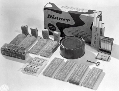 Dinner Unit  Canned cheese product Biscuits A candy bar Chewing gum Powdered beverage Granulated sugar Salt tablets Cigarettes Matches Can opener  Wooden spoon